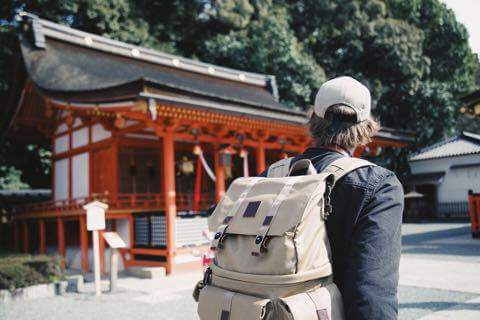 japanese shrine and backpacker (Photo by bobby hendry on Unsplash)